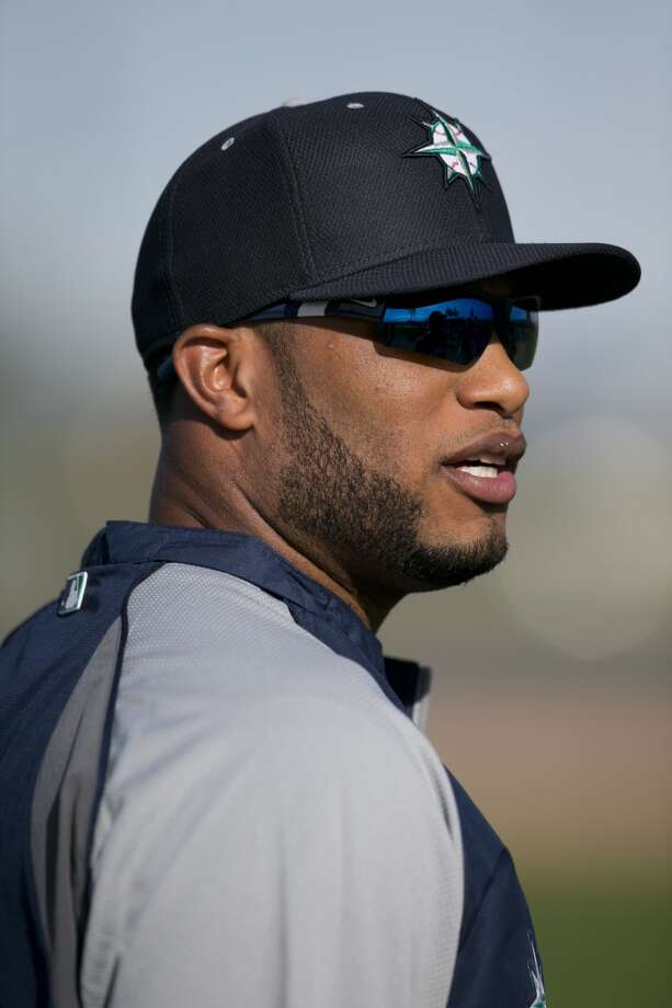 Seattle Mariners second baseman Robinson Cano looks on during spring training baseball practice, Tuesday, Feb. 18, 2014, in Peoria, Ariz. (AP Photo/The Arizona Republic, David Wallace) Photo: AP