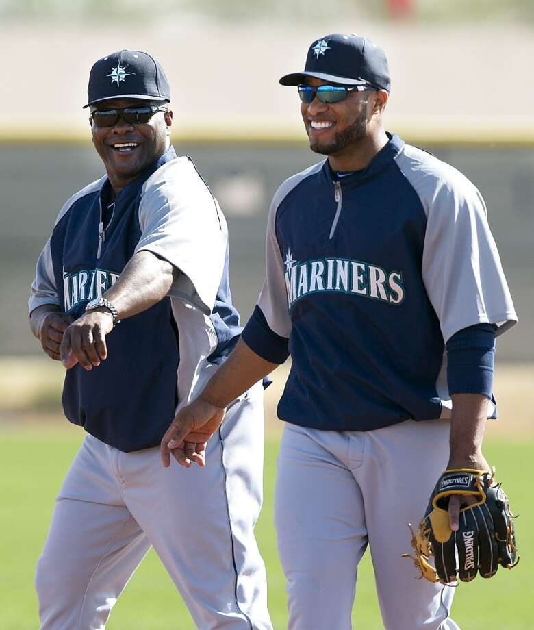 Seattle Mariners manager Lloyd McClendon, left, and second baseman Robinson Cano talk during spring training baseball practice, Tuesday, Feb. 18, 2014, in Peoria, Ariz. (AP Photo/The Arizona Republic, David Wallace) Photo: AP