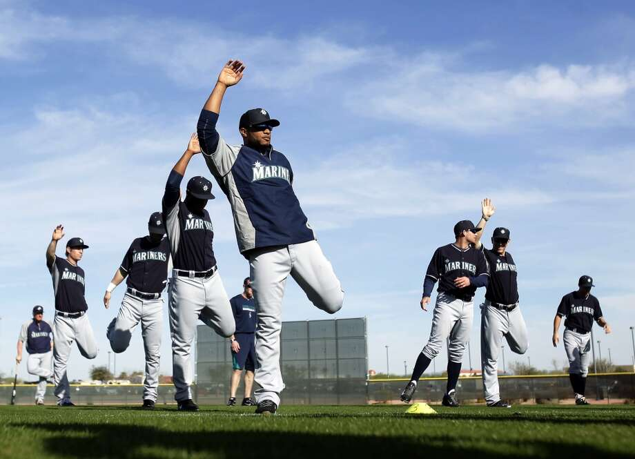 Seattle Mariners second baseman Robinson Cano, front, stretches with his teammates before baseball spring training, Tuesday, Feb. 18, 2014, in Peoria, Ariz. (AP Photo/Rick Scuteri) Photo: ASSOCIATED PRESS