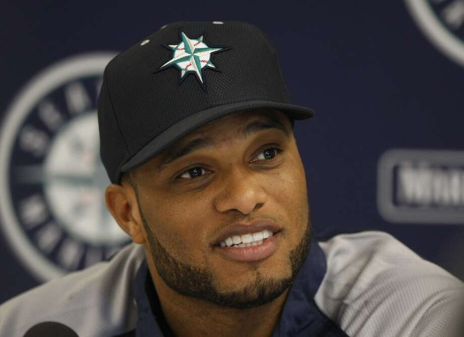 Seattle Mariners second baseman Robinson Cano (22) speaks to reporters after spring training baseball practice, Tuesday, Feb. 18, 2014, in Peoria, Ariz. (AP Photo/Rick Scuteri) Photo: AP
