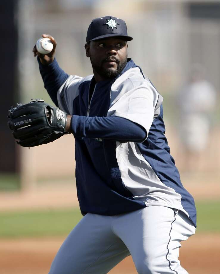 Seattle Mariners relief pitcher Fernando Rodney (56) throws to firstbase during spring training baseball practice, Tuesday, Feb. 18, 2014, in Peoria, Ariz. (AP Photo/Rick Scuteri) Photo: AP