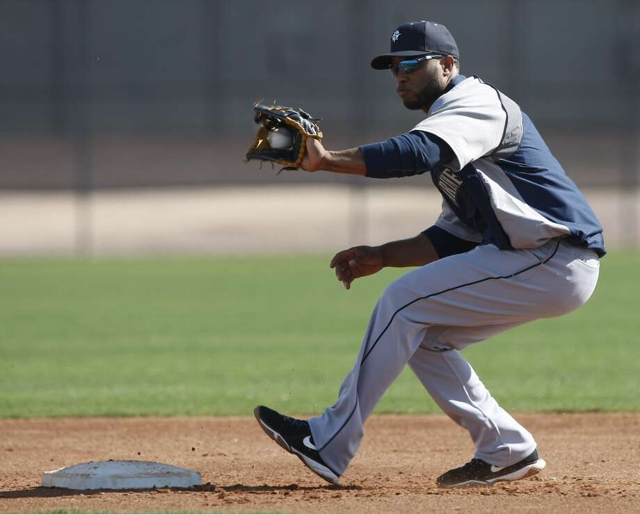 Seattle Mariners second baseman Robinson Cano (22) covers second base during spring training baseball practice, Tuesday, Feb. 18, 2014, in Peoria, Ariz. (AP Photo/Rick Scuteri) Photo: AP