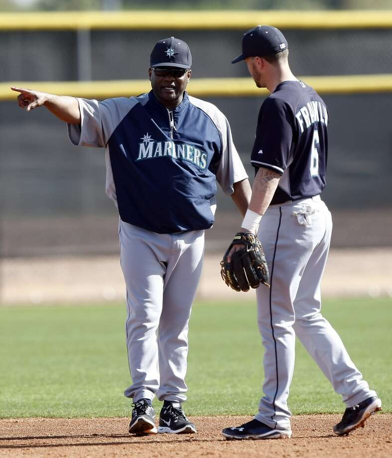 Seattle Mariners manager Lloyd McClendon (23), left, talks to Nick Franklin (6) during spring training baseball practice, Tuesday, Feb. 18, 2014, in Peoria, Ariz. (AP Photo/Rick Scuteri) Photo: AP