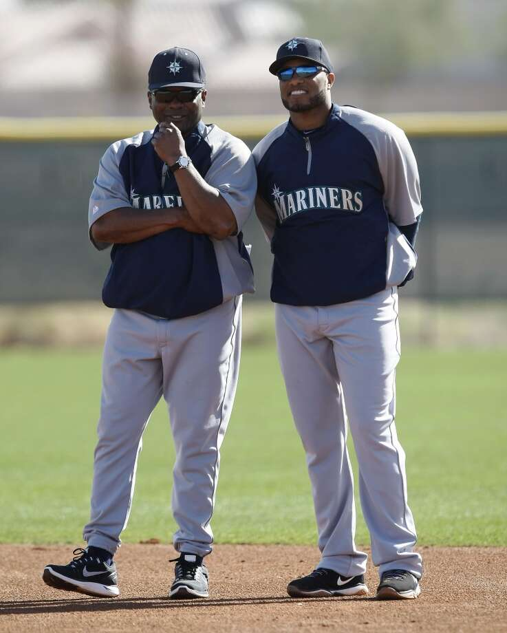 Seattle Mariners manager Lloyd McClendon (23), left, talks to Robinson Cano (22) during spring training baseball practice, Tuesday, Feb. 18, 2014, in Peoria, Ariz. (AP Photo/Rick Scuteri) Photo: AP