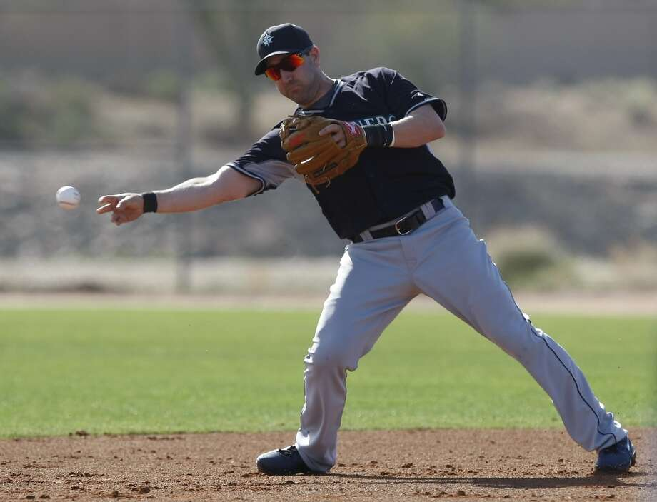 Seattle Mariners infielder Willie Bloomquist (8) throws to second base during spring training baseball practice, Tuesday, Feb. 18, 2014, in Peoria, Ariz. (AP Photo/Rick Scuteri) Photo: AP