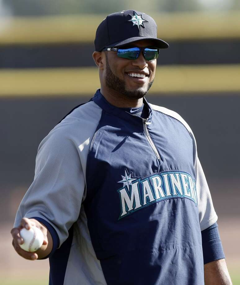 Seattle Mariners second baseman Robinson Cano warms up during spring training baseball practice, Tuesday, Feb. 18, 2014, in Peoria, Ariz. (AP Photo/Rick Scuteri) Photo: AP