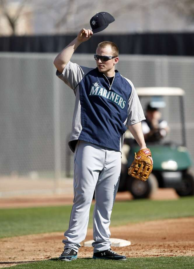 Seattle Mariners third baseman Kyle Seager (15) acknowledges the fans during spring training baseball practice, Tuesday, Feb. 18, 2014, in Peoria, Ariz. (AP Photo/Rick Scuteri) Photo: AP