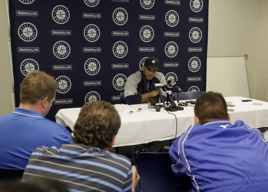 Seattle Mariners second baseman Robinson Cano (22) acknowledges the media after spring training baseball practice, Tuesday, Feb. 18, 2014, in Peoria, Ariz. (AP Photo/Rick Scuteri) Photo: AP