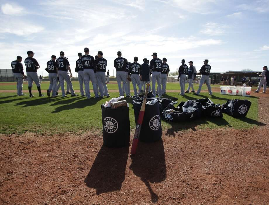 Seattle Mariners players meet during spring training baseball practice, Tuesday, Feb. 18, 2014, in Peoria, Ariz. (AP Photo/Rick Scuteri) Photo: AP