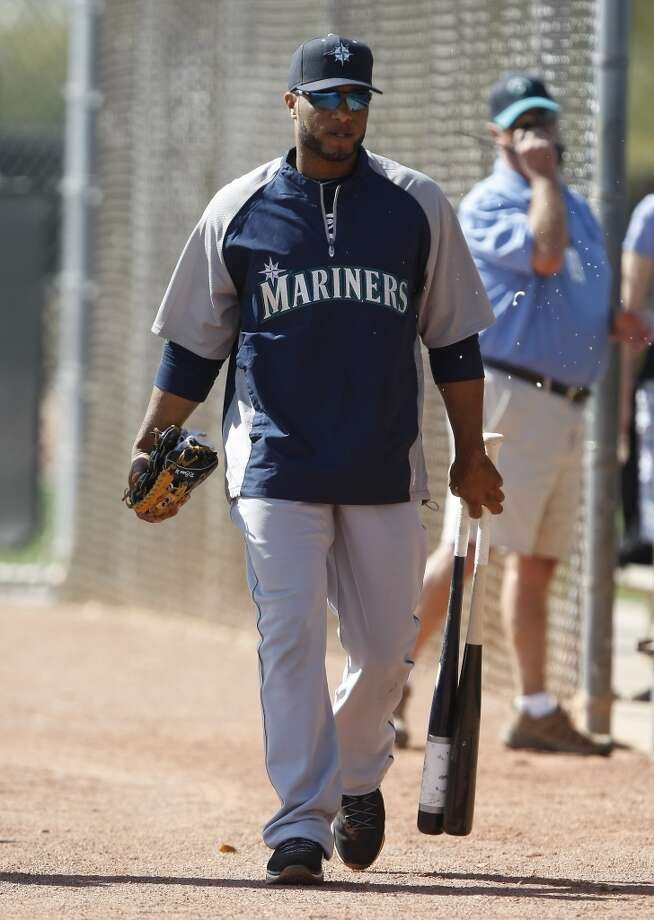 Seattle Mariners second baseman Robinson Cano (22) walks to spring training baseball practice, Tuesday, Feb. 18, 2014, in Peoria, Ariz. (AP Photo/Rick Scuteri) Photo: AP