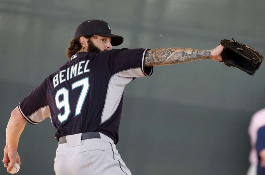 Seattle Mariners pitcher Joe Beimel (97) throws in the bullpen during spring training baseball practice, Tuesday, Feb. 18, 2014, in Peoria, Ariz. (AP Photo/Rick Scuteri) Photo: AP