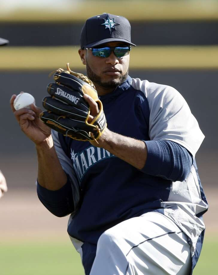 Seattle Mariners second baseman Robinson Cano (22) stretches during spring training baseball practice, Tuesday, Feb. 18, 2014, in Peoria, Ariz. (AP Photo/Rick Scuteri) Photo: ASSOCIATED PRESS