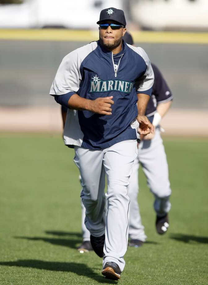 Seattle Mariners second baseman Robinson Cano (22) stretches during spring training baseball practice, Tuesday, Feb. 18, 2014, in Peoria, Ariz. (AP Photo/Rick Scuteri) Photo: AP