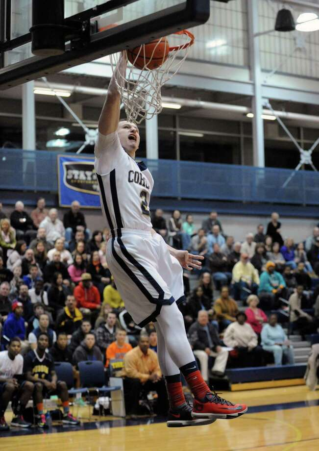 Brandon LaForest dunks the ball for a score during their Class B sectional boy's basketball game against Hudson on Tuesday Feb. 18, 2014 in Cohoes, N.Y. (Michael P. Farrell/Times Union) Photo: Michael P. Farrell / 00025797A