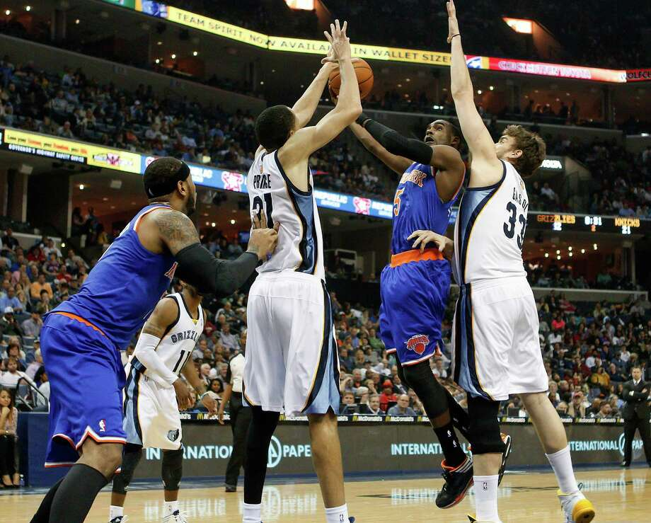 New York Knicks guard Tim Hardaway, Jr. (5) goes to the basket against Memphis Grizzlies forward Tayshaun Prince (21) and center Marc Gasol (33), of Spain, in the first half of an NBA basketball game Tuesday, Feb. 18, 2014, in Memphis, Tenn. (AP Photo/Lance Murphey) ORG XMIT: TNLM105 Photo: Lance Murphey / FR78211 AP