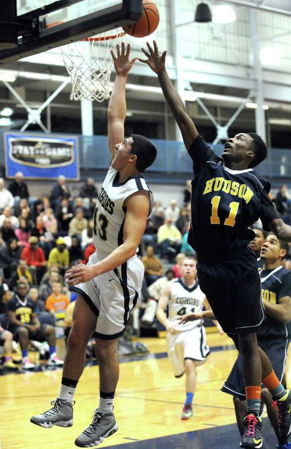 Cohoes Max Carey goes in for a score during their Class B sectional boy's basketball game against Hudson on Tuesday Feb. 18, 2014 in Cohoes, N.Y. (Michael P. Farrell/Times Union) Photo: Michael P. Farrell / 00025797A