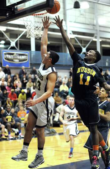 Cohoes Max Carey goes in for a score during their Class B sectional boy's basketball game against Hu