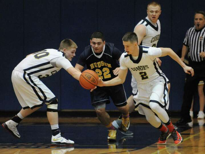Cohoes Brandon LaForest, right, steals the ball from Hudson's T.J. Gardner during their Class B sect