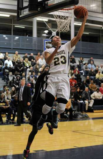 Cohoes Shelton Alston goes in for a score during their Class B sectional boy's basketball game again