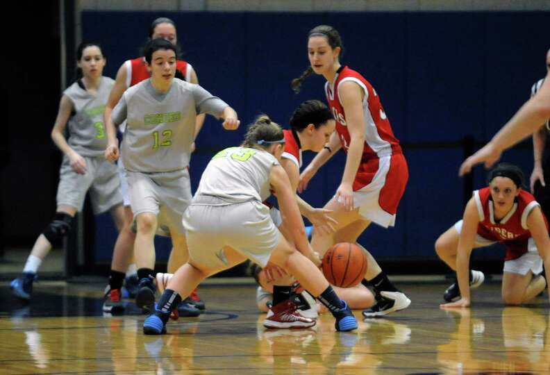Mechanicville and Cohoes players battle for a loose ball during their Class B girl's basketball game