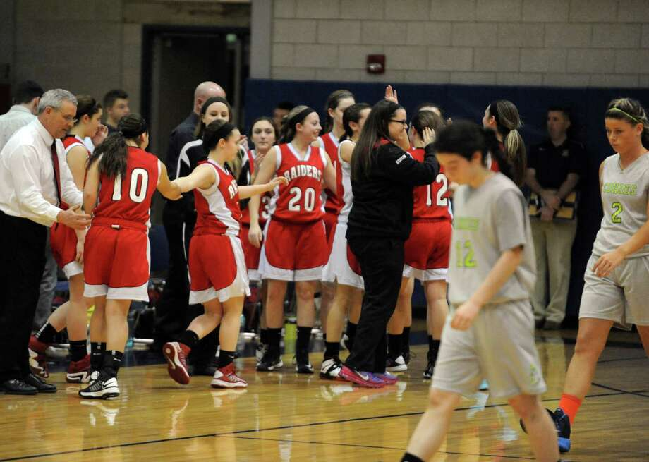 Mechanicville celebrates after defeating Cohoes in their Class B girl's basketball game on Tuesday Feb. 18, 2014 in Cohoes, N.Y. (Michael P. Farrell/Times Union) Photo: Michael P. Farrell / 00025798A