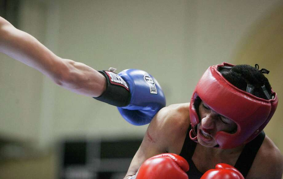 Jacob Macias of Champion Fit Gym tries to evade a punch from Angel Gongora of Elizando Boxing Club during the San Antonio Regional Golden Gloves at Woodlawn Gym. Gongora won. Photo: Julysa Sosa / For The Express-News / Julysa Sosa/ San Antonio Express-News