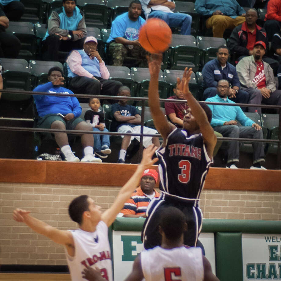T. Lott of Port Arthur shoots the ball Tuesday night at the East Chambers gymnasium in Winnie, Tx. Photo provided by Michael Reed Photo: Michael Reed / Michael Reed