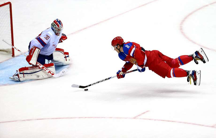 *** BESTPIX *** SOCHI, RUSSIA - FEBRUARY 18:  Alexander Ovechkin #8 of Russia falls to the ice against Lars Haugen #30 of Norway during the Men's Ice Hockey Qualification Playoff game on day eleven of the Sochi 2014 Winter Olympics at Bolshoy Ice Dome on February 18, 2014 in Sochi, Russia.  (Photo by Streeter Lecka/Getty Images) Photo: Streeter Lecka, Getty Images