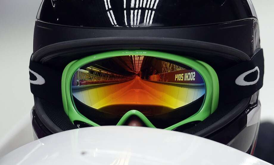 The track is reflected in the goggles of Canada's CAN-2, pilot Jennifer Ciochetti as she start their first run during the women's two-man bobsled competition at the 2014 Winter Olympics, Tuesday, Feb. 18, 2014, in Krasnaya Polyana, Russia. (AP Photo/Natacha Pisarenko) Photo: Natacha Pisarenko, Associated Press