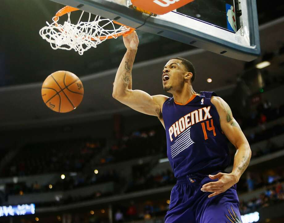 Gerald Green dunks in overtime, when he had eight of his career-high 36 points to power Phoenix to victory in Denver. Photo: Chris Humphreys, Reuters