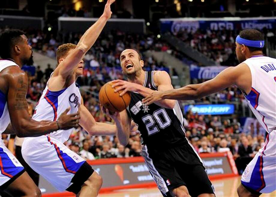 San Antonio Spurs guard Manu Ginobili (20), of Argentina, drives on Los Angeles Clippers forward Blake Griffin. left center,  center DeAndre Jordan, left, and forward Jared Dudle, right, as he goes to the basket in the first half of a NBA basketball game, Tuesday, Feb. 18, 2014, in Los Angeles.(AP Photo/Gus Ruelas) Photo: Gus Ruelas, AP / FR157633 AP