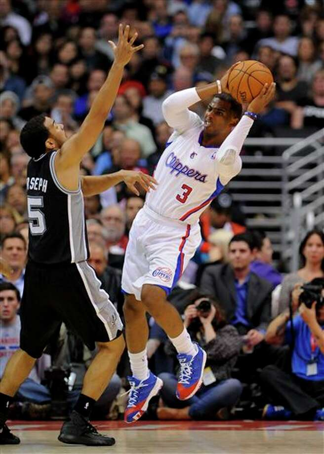 Los Angeles Clippers guard Chris Paul (3) looks around San Antonio Spurs guard Cory Joseph (5) for the open man in the first half of a NBA basketball game, Tuesday, Feb. 18, 2014, in Los Angeles.(AP Photo/Gus Ruelas) Photo: Gus Ruelas, AP / FR157633 AP