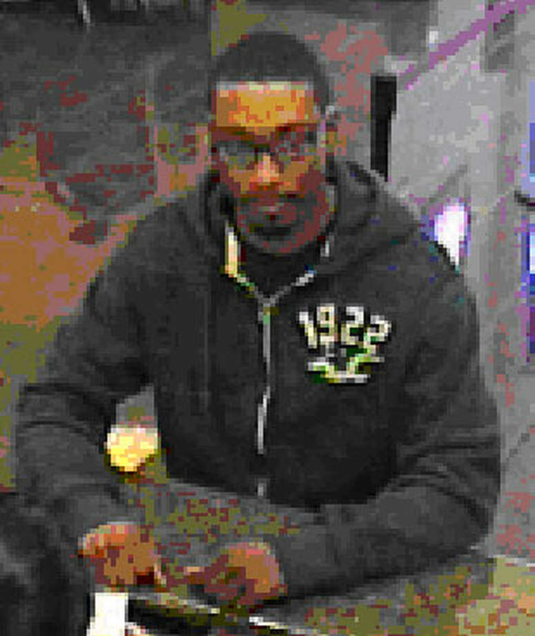 A robbery occurred at the IBC Bank on Feb 16, 2014.  If anyone has information on the identity or whereabouts of the suspect pictured below, we urge you to contact police. Photo: Courtesy