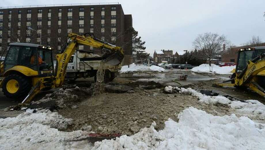 Sixth Avenue in Troy was closed Wednesday morning while crews tried to repair a 12-inch water pipe that ruptured outside the ain water break right in front of the O'Neil Apartments. (Skip Dickstein / Times Union)
