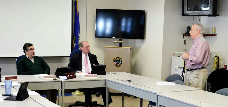 First Selectman Robert Mallozzi, left, and Selectman Nick Williams watch Public Works Director Michael Pastore addressing the board on Feb. 11, 2014, at the New Canaan police station. According to Pastore, the bitter cold temperatures this winter has caused over $100,000 in water and freeze damage at the Nature Center and the New Canaan Playhouse. Photo: Nelson Oliveira / New Canaan News