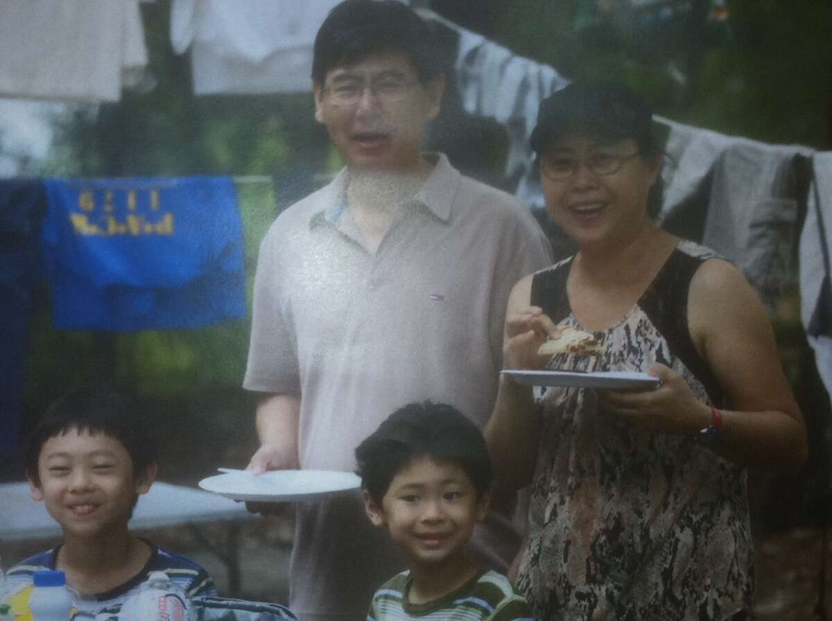 Maoye Sun and Mei Xie and their young sons, 9-year-old Timothy Sun and 7-year-old Titus Sun, were found shot to death about 7:30 p.m. Jan. 30 inside their house in the 14000 block of Fosters Creek Drive. (Dale Lezon / Houston Chronicle)