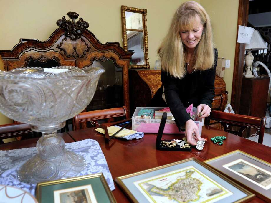 Donna Moore sorts through some jewelry in the warehouse she uses for her company, New England Auction Co., in Danbury, Conn., Tuesday, Feb. 18, 2014. Photo: Carol Kaliff / The News-Times