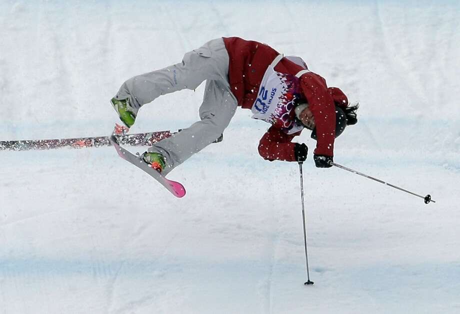 Canada's Yuki Tsubota crashes on her last run in the women's freestyle skiing slopestyle final at the Rosa Khutor Extreme Park, at the 2014 Winter Olympics, Tuesday, Feb. 11, 2014, in Krasnaya Polyana, Russia.  (AP Photo/Andy Wong) Photo: Andy Wong, Associated Press
