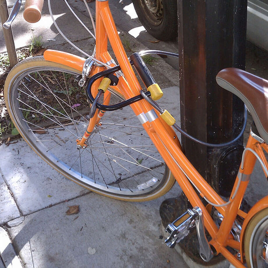 Poorly locked bike: Although this bike has a U-lock on the frame, it is not secured around a stationary object, nor does it secure the wheel to the frame. Only an easily cut cable keeps this bike from rolling off.