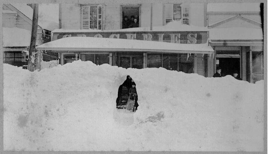 Snow piled high on Main Street in front of Taylor and Richards Grocery store after the blizzard of 1888. Photo: Westport Historical Society / Westport News contributed