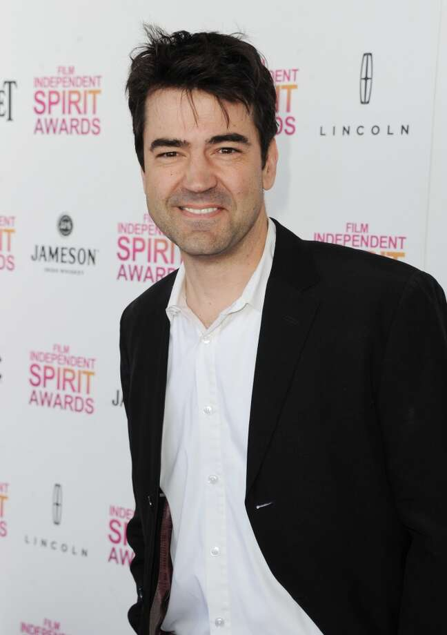 """These days, Ron Livingston doesn't have to concoct any schemes to keep his bank account in check (thanks in large part to HBO). We've seen him over the years in memorable roles, including HBO's """"Band of Brothers,"""" """"Sex in the City"""" (How can we forget the Post-It break up note, ladies?) and most recently in """"Boardwalk Empire."""" He just finished up the war drama """"Fort Bliss"""" and is currently working on """"Supreme Ruler."""" Photo: Kevin Winter, Getty Images"""