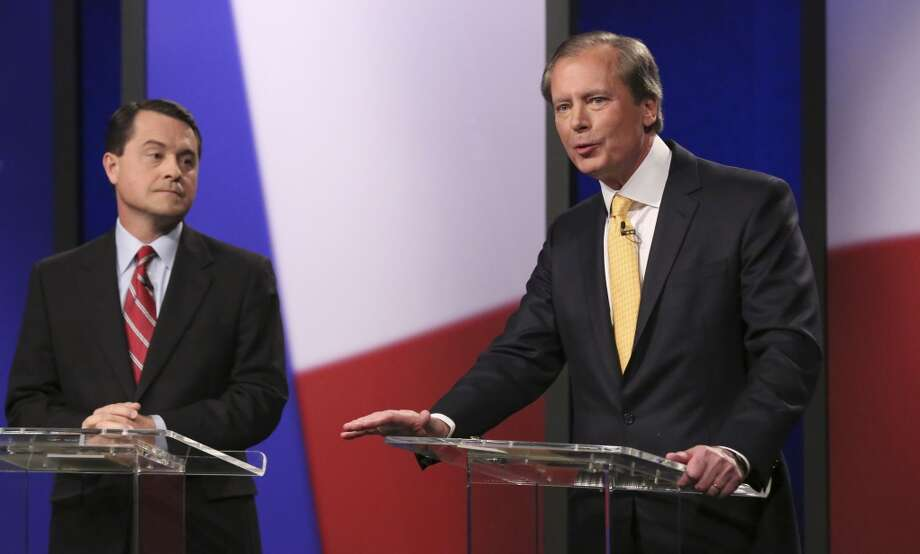 Republican Texas lieutenant governor candidates  Agricultural Commissioner Todd Staples looks on as  Lt. Gov. David Dewhurst speaks during a debate at KERA studios in Dallas, Monday, Jan. 27, 2014.  The four Republican candidates are vying to be Texas lieutenant governor, a post considered to be the most powerful in the state. (AP Photo/LM Otero,Pool) Photo: LM Otero, Associated Press