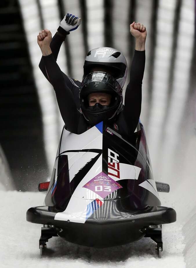 The team from the United States USA-2, piloted by Jamie Greubel with brakeman Aja Evans, cross into the finish area to win the bronze medal in the women's bobsled competition at the 2014 Winter Olympics, Wednesday, Feb. 19, 2014, in Krasnaya Polyana, Russia. (AP Photo/Michael Sohn) Photo: Michael Sohn, Associated Press