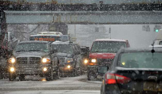 Snow slows traffic on Albany Shaker Road Wednesday Feb. 19, 2014, in Colonie, NY. (John Carl D'Annibale / Times Union) Photo: John Carl D'Annibale