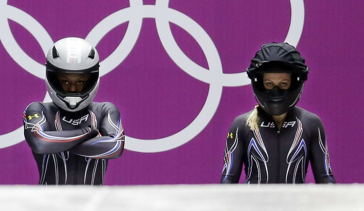 The team from the United States USA-2, piloted by Jamie Greubel with brakeman Aja Evans, left, prepare to start their third run during the women's bobsled competition at the 2014 Winter Olympics, Wednesday, Feb. 19, 2014, in Krasnaya Polyana, Russia.