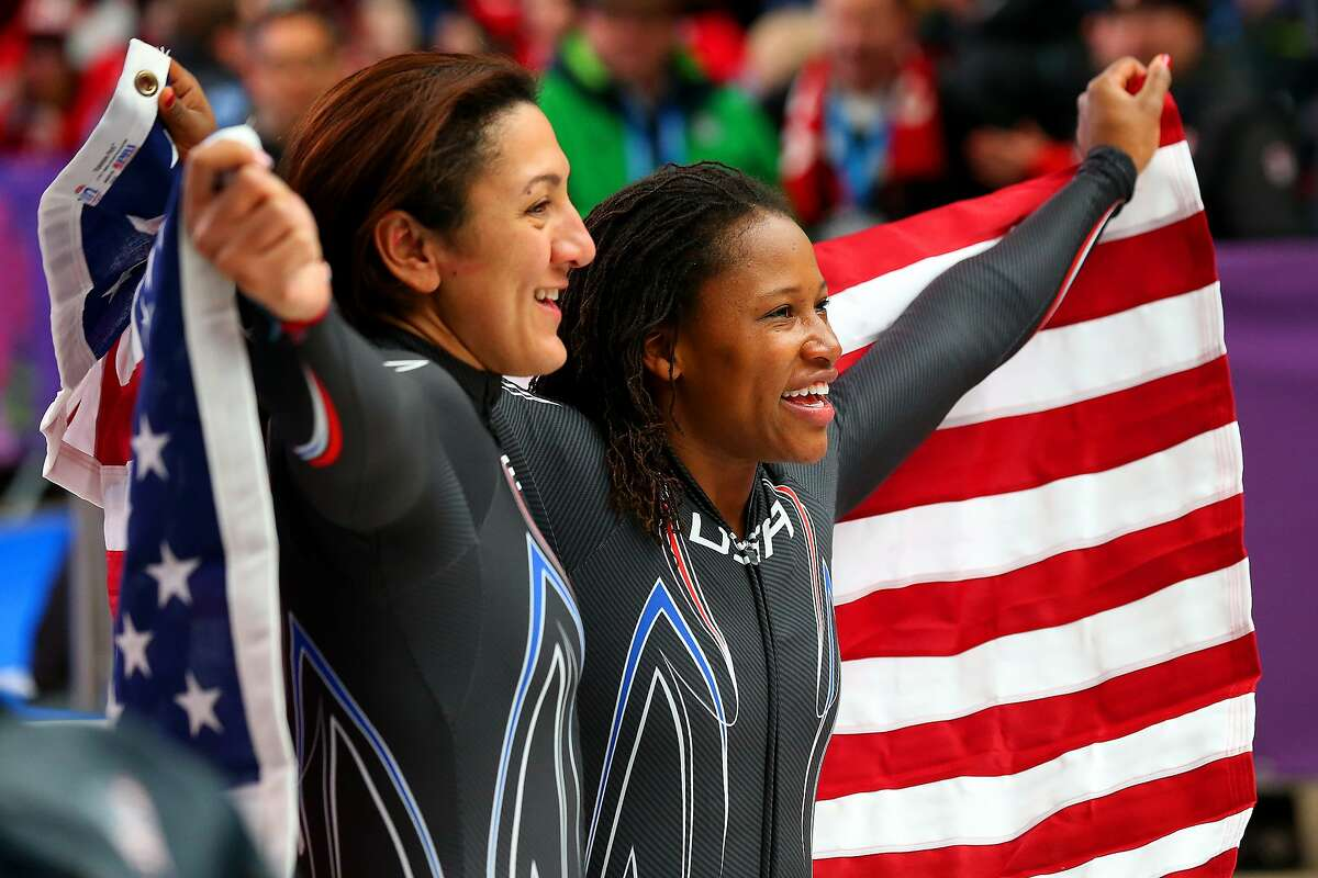 Silver medallists Elana Meyers (L) and Lauryn Williams of the United States team 1 pose during the Women's Bobsleigh on Day 12 of the Sochi 2014 Winter Olympics at Sliding Center Sanki on February 19, 2014 in Sochi, Russia.
