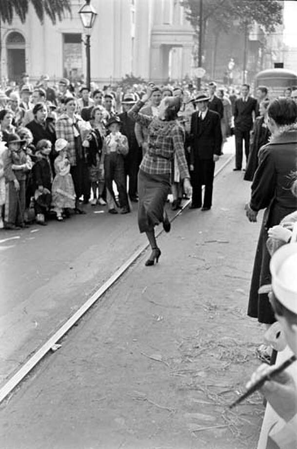 People dance in the streets during Mardi Gras celebrations in New Orleans, Louisiana in February 1938. Photo: William Vandivert, Time & Life Pictures/Getty Image / Time & Life Pictures