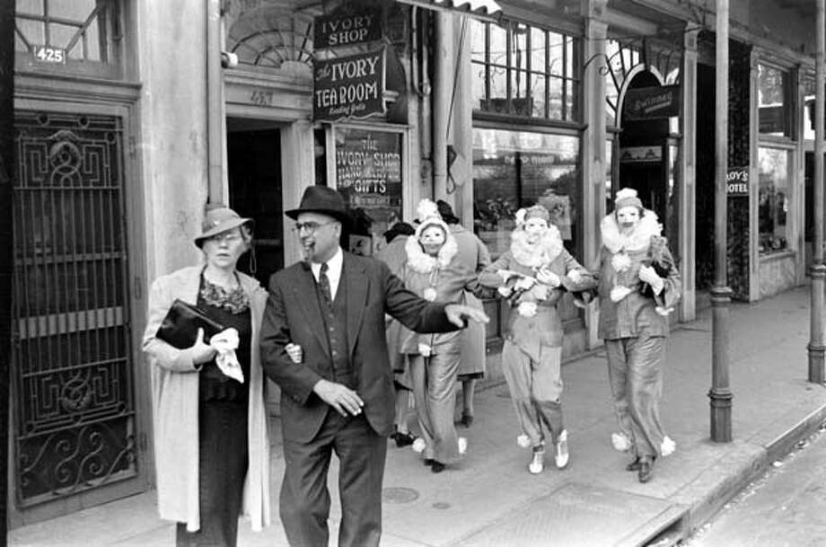 A pair of pedestrians are followed down the sidewalk by a trio of costumed revelers during the Mardi Gras celebrations in New Orleans, Louisiana in February 1938. Photo: William Vandivert, Time & Life Pictures/Getty Image / Time & Life Pictures