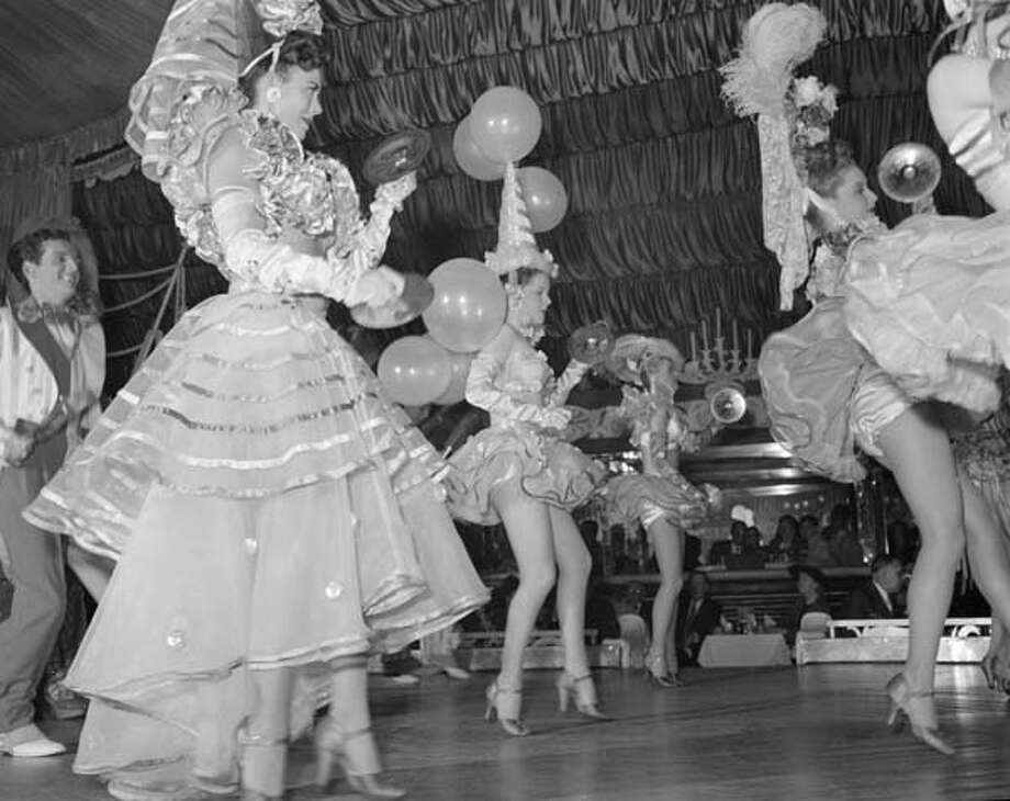 A dance ensemble entertain guests at a masquerade in the Latin Quarter of New Orleans, Louisiana circa 1948. Photo: Three Lions, Getty Images / Hulton Archive