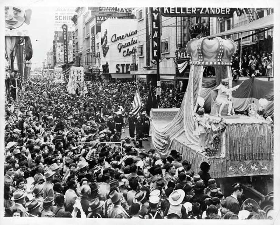 A view as floats travel down Canal street for Mardi Gras in New Orleans, Louisiana circa 1950. Photo: Pictorial Parade, Getty Images / 2013 Getty Images